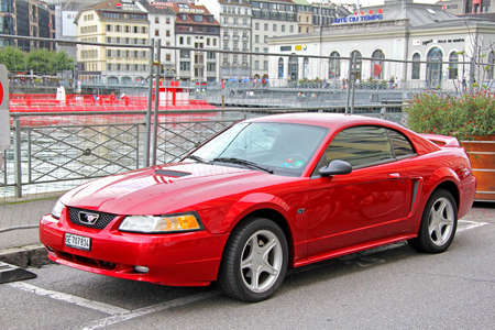 mustang gt: GENEVA, SWITZERLAND - AUGUST 4, 2014: Retro sports car Ford Mustang at the city street.