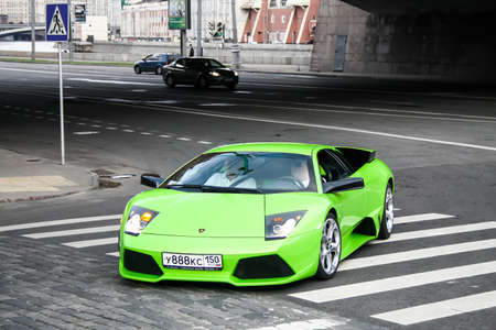 supercar: MOSCOW, RUSSIA - JULY 9, 2011: Green supercar Lamborghini Murcielago at the city street. Editorial