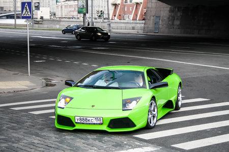 lamborghini: MOSCOW, RUSSIA - JULY 9, 2011: Green supercar Lamborghini Murcielago at the city street. Editorial