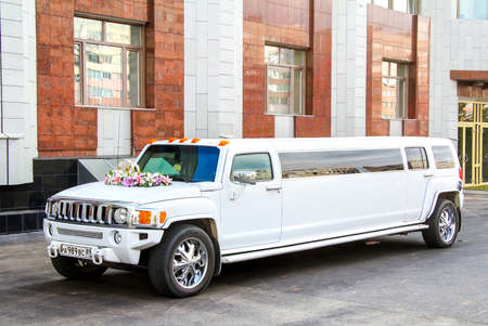 NOVYY URENGOY, RUSSIA - AUGUST 31, 2012: White limousine Hummer H3 at the city street. Editorial