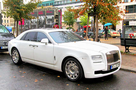 car carrier: BERLIN, GERMANY - SEPTEMBER 11, 2013: Modern luxury car Rolls-Royce Ghost at the city street near the hotel.