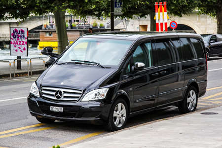 minivan: GENEVA, SWITZERLAND - AUGUST 4, 2014: Black luxury van Mercedes-Benz W639 Vito at the city street.