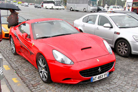 supercar: PARIS, FRANCE - AUGUST 8, 2014: Rental supercar Ferrari California at the city street.