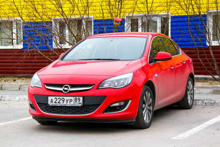 NOVYY URENGOY, RUSSIA - JUNE 11, 2014: Motor car Opel Astra at the city street. Editorial