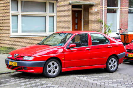 alfa: AMSTERDAM, NETHERLANDS - AUGUST 10, 2014: Motor car Alfa Romeo 146 at the city street.