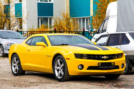 motor car: NOVYY URENGOY, RUSSIA - SEPTEMBER 9, 2012: Motor car Chevrolet Camaro at the city street.