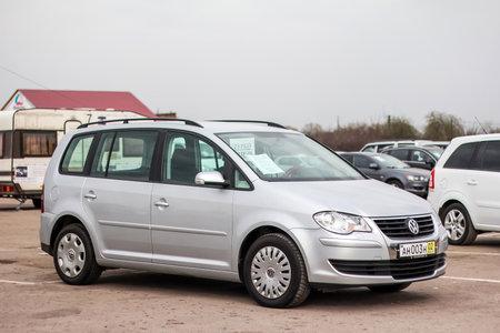 mpv: UFA, RUSSIA - APRIL 19, 2012: Motor car Volkswagen Touran at the used cars trade center.