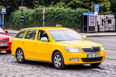 a yellow taxi: PRAGUE, CZECH REPUBLIC - JULY 21, 2014: Yellow taxi car Skoda Octavia at the city street.