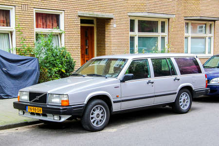 capacious: AMSTERDAM, NETHERLANDS - AUGUST 10, 2014: Motor car Volvo 700 Series at the city street.