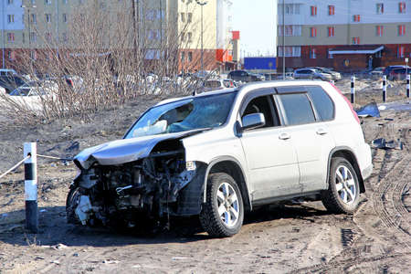 contorted: NOVYY URENGOY, RUSSIA - APRIL 25, 2015: Grey Nissan X-Trail after the accident at the city street.
