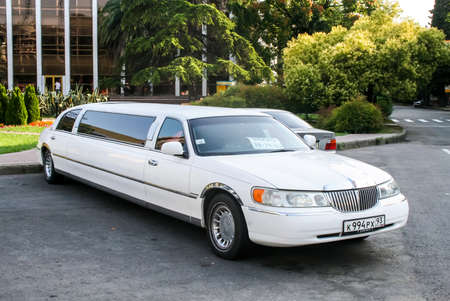 limousine: SOCHI, RUSSIA - JULY 19, 2009: White limousine Lincoln Town Car at the city street.