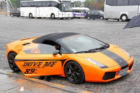gallardo: PARIS, FRANCE - AUGUST 8, 2014: Rental supercar Lamborghini Gallardo Spyder at the city street.