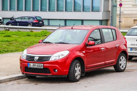 cheapness: BERLIN, GERMANY - SEPTEMBER 12, 2013: Motor car Dacia Sandero at the city street.