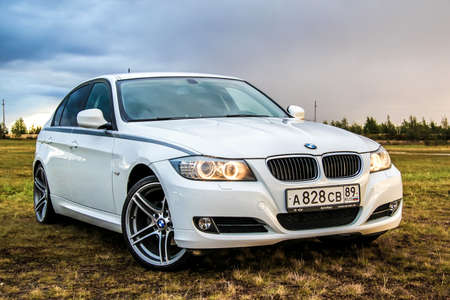NOVYY URENGOY, RUSSIA - AUGUST 21, 2015: Motor car BMW E90 318i at the countryside. Editorial