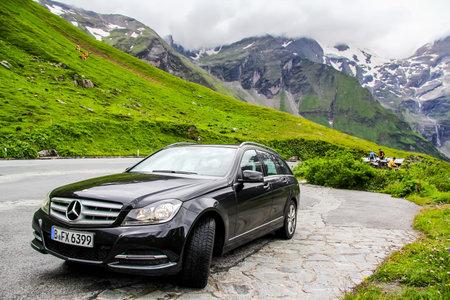 benz: TYROL, AUSTRIA - JULY 29, 2014: Black estate car Mercedes-Benz W204 C180 at the Grossglockner High Alpine road. Editorial