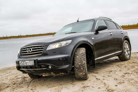 crossover: NOVYY URENGOY, RUSSIA - SEPTEMBER 14, 2014: Black crossover Infiniti FX45 at the countryside.