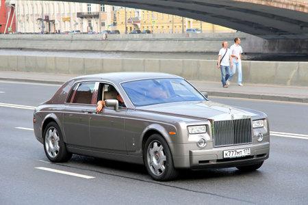 phantom: MOSCOW, RUSSIA - JULY 7, 2012: Silver premium class sedan Rolls-Royce Phantom SWB at the city street.