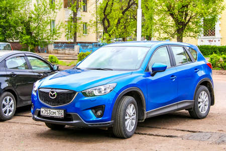 mazda: UFA, RUSSIA - MAY 3, 2012: Motor car Mazda CX-5 at the city street.
