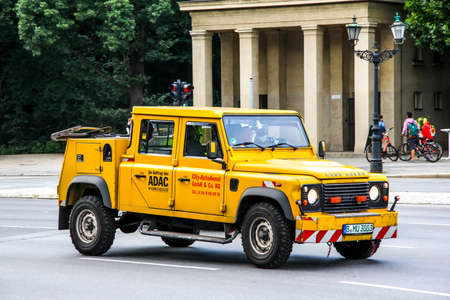defender: BERLIN, GERMANY - AUGUST 15, 2014: Tow truck Land Rover Defender at the city street.
