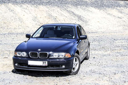 sand quarry: NOVYY URENGOY, RUSSIA - JULY 12, 2014: Motor car BMW E39 520i at the sand quarry. Editorial