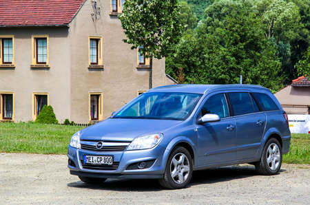 KOENIGSBRUECK, GERMANY - JULY 20, 2014: Motor car Opel Astra at the town street. Editorial
