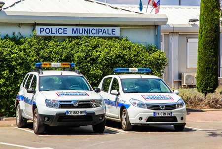 motor officer: SAINT-TROPEZ, FRANCE - AUGUST 3, 2014: Police cars Dacia Duster and Dacia Sandero at the city street.