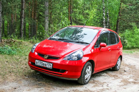 MIASS, RUSSIA - JUNE 12, 2009: Motor car Honda Fit in the forest. Editorial
