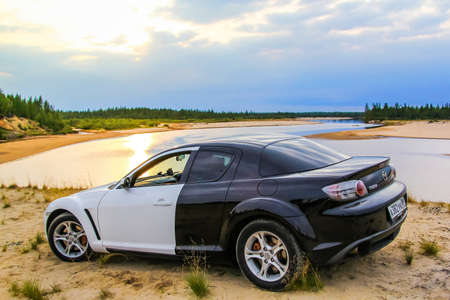 mazda: NOVYY URENGOY, RUSSIA - AUGUST 16, 2015: Motor car Mazda RX-8 at the countryside.
