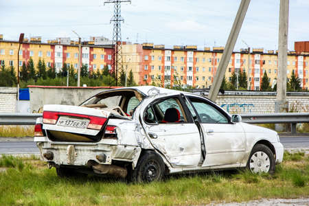 nissan: NOVYY URENGOY, RUSSIA - AUGUST 16, 2015: Crashed motor car Nissan Sunny at the city street. Editorial