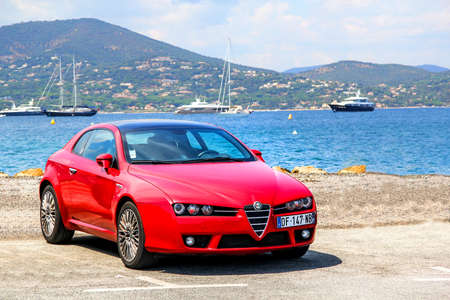 romeo: SAINT-TROPEZ, FRANCE - AUGUST 3, 2014: Motor car Alfa Romeo Brera at the city street.