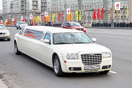 limo: MOSCOW, RUSSIA - MAY 5, 2012: White limousine Chrysler 300C at the city street.