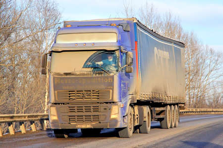 very dirty: BASHKORTOSTAN, RUSSIA - MARCH 11, 2015: Very dirty semi-trailer truck Volvo FH12 at the interurban road. Editorial