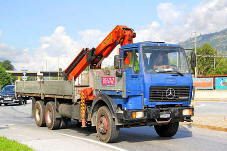 flatbed truck: VALAIS, SWITZERLAND - AUGUST 5, 2014: Old blue flat-bed truck Mercedes-Benz SK at the interurban road. Editorial