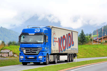 semitrailer: TYROL, AUSTRIA - JULY 29, 2014: Blue semi-trailer truck Mercedes-Benz Actros at the high Alpine road. Editorial