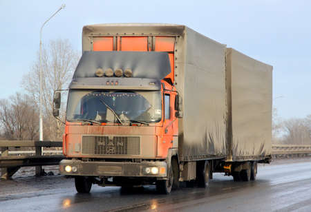 very dirty: BASHKORTOSTAN, RUSSIA - MARCH 11, 2015: Very dirty cargo truck MAN M90 at the interurban road.
