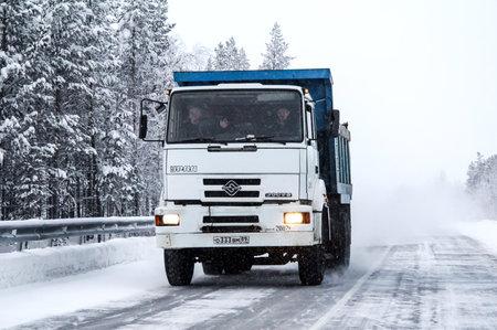 dump truck: YAMAL, RUSSIA - DECEMBER 1, 2012: Dump truck Ural 63685 at the snowy interurban road.