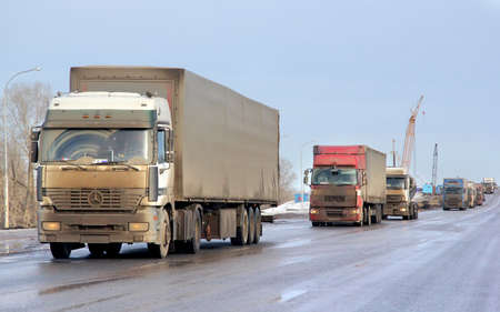 very dirty: BASHKORTOSTAN, RUSSIA - MARCH 11, 2015: Very dirty semi-trailer truck Mercedes-Benz Actros at the interurban road.