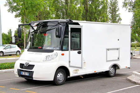 commercial tree service: FRANCE - AUGUST 7, 2014: White shop car Etalmobil Etaleo at the city street.