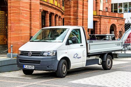utilitarian: FRANKFURT AM MAIN, GERMANY - SEPTEMBER 15, 2013: Motor car Volkswagen Transporter at the city street,