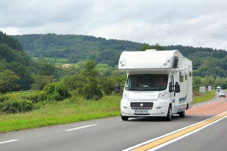 motor home: RHONE-ALPES, FRANCE - AUGUST 7, 2014: White motorhome Fiat Ducato at the interurban road.