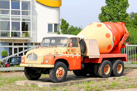 beton: PRAGUE, CZECH REPUBLIC - JULY 22, 2014: Monument of the vintage concrete mixer truck Tatra 138 near the Zapa Beton a.s. trade center.
