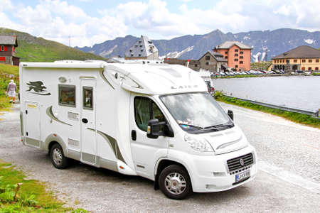 motor home: GOTTHARD PASS, SWITZERLAND - AUGUST 5, 2014: White Fiat Ducato based Laika campervan at the high Alpine mountain road. Editorial