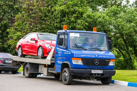 moving truck: MOSCOW, RUSSIA - JUNE 2, 2012: Blue tow truck Mercedes-Benz Vario 614D at the city street.