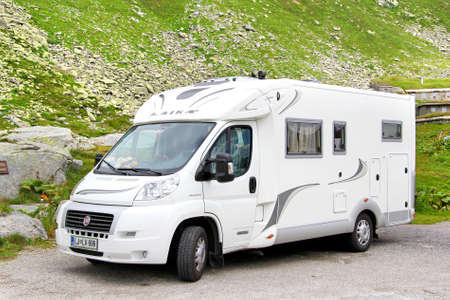 campervan: GOTTHARD PASS, SWITZERLAND - AUGUST 5, 2014: White Fiat Ducato based Laika campervan at the high Alpine mountain road. Editorial