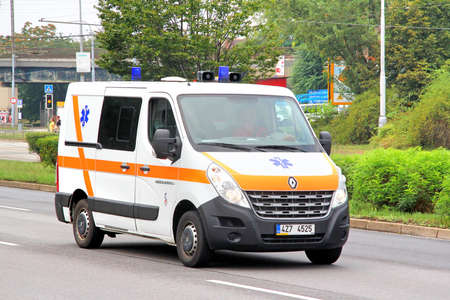 cross street with care: BRNO, CZECH REPUBLIC - JULY 22, 2014: Ambulance car Renault Master at the city street.