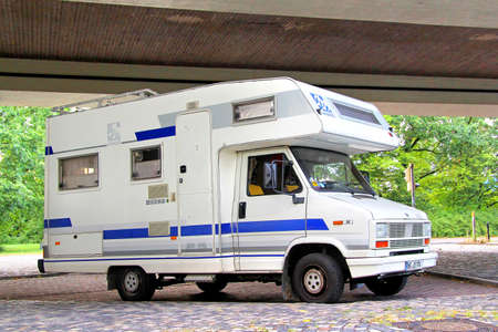 is based: BREMEN, GERMANY - AUGUST 10, 2014: Old Fiat Ducato based motorhome Knaus at the city street.
