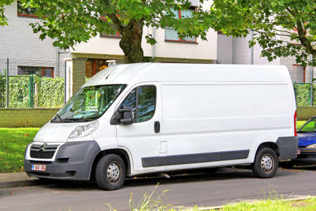 vans: BRUSSELS, BELGIUM - AUGUST 9, 2014: White cargo van Citroen Jumpy at the city street.