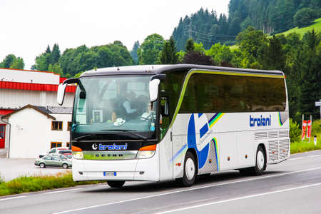 intercity: VALAIS, SWITZERLAND - JULY 29, 2014: Modern interurban coach Setra S415HD at the intercity freeway.