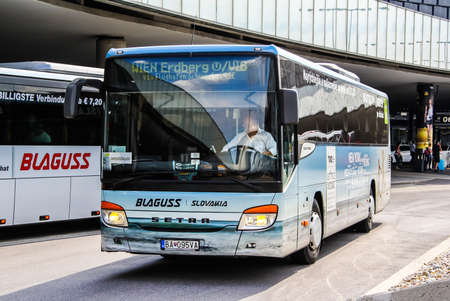 intercity: VIENNA, AUSTRIA - JULY 24, 2014: Intercity coach Setra S415UL at the parking of the Vienna International Airport. Editorial