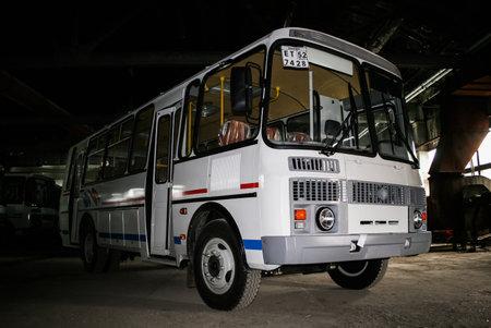 hangar: ASHA, RUSSIA - JUNE 30, 2008: Brand new bus PAZ 4234 in the dark hangar. Editorial